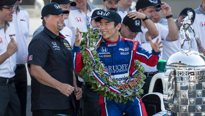 Andretti Autosport IndyCar driver Takuma Sato, winner of the 101st running of the Indianapolis 500, and team owner Michael Andretti and their team pose for photos with the Borg-Warner trophy at Indianapolis Motor Speedway Monday, May 29, 2017.