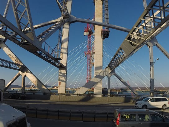Cables are added to the main span support towers during