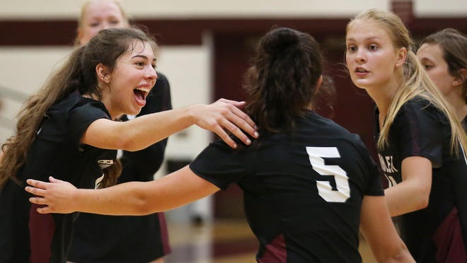 Buhler's Blythe Adkins (18) celebrates a point with teammates during their game against Rose Hill Tuesday. Buhler defeated Rose Hill 25-13, 25-19.