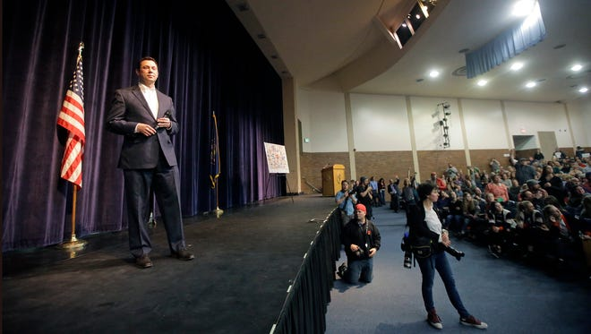 Rep. Jason Chaffetz speaks during a town hall meeting at Brighton High School, Thursday, Feb. 9, 2017, in Cottonwood Heights, Utah. Hundreds of people lined up early for a town hall with Chaffetz on Thursday evening, many holding signs criticizing the congressman's push to repeal the newly-named Bears Ears National Monument in southern Utah.