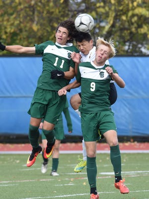 Spackenkill's Jake Kaufman, right, and Andrew Moreira, left, collide with Fallburg's Kevin Manjarrez, center, during Friday's Section 9 Class B final.