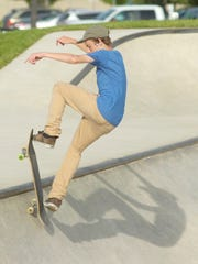 Hunter Ray, 15, from Livonia comes off his skateboard during a trick.