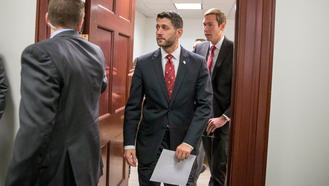 House Speaker Paul Ryan of Wis., emerges from a closed-door GOP strategy session at the Capitol in Washington, Tuesday, Dec. 1, 2015.    (AP Photo/J. Scott Applewhite)