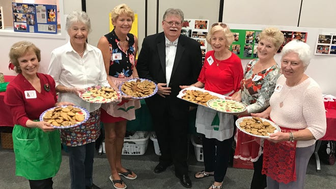 Palm City Cookie Ladies with James LeBon, center, are, from left, Pat Tiemeyer, Doris Hofmann, Sherry Walker, Yvonne Pryhuber, Donna Gans and Pat Northcutt. Other bakers included Nancy Cassell, Sherrie Swygert and Lori Baird. LeBon is band director at Southpark Middle School and conducted the Stuart Community Concert Band's holiday show.