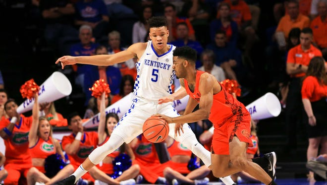 Kentucky Wildcats forward Kevin Knox (5) guards Florida Gators guard Jalen Hudson (3) during the first half at Exactech Arena at the Stephen C. O'Connell Center in Gainesville, Florida, on Saturday, March 3, 2018.