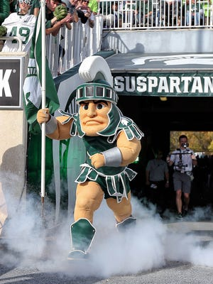 Michigan State mascot Sparty takes the field prior to a game against the Indiana Hoosiers at Spartan Stadium.