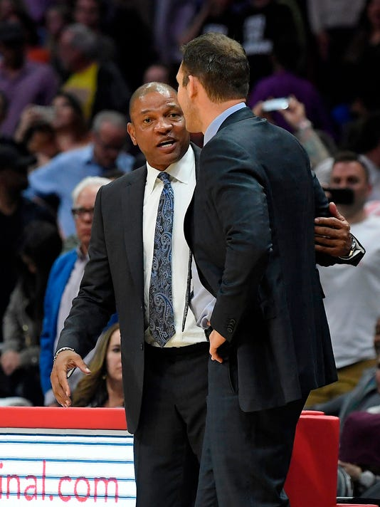 Los Angeles Clippers coach Doc Rivers, left, talks with Los Angeles Lakers coach Luke Walton after an NBA basketball game Wednesday, April 11, 2018, in Los Angeles. The Lakers won 115-100. (AP Photo/Mark J. Terrill)