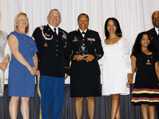 Master Sgt. Erica Haywood, center, was one of 80 volunteers who were recognized at a recent ceremony and dinner. She works at the U.S. Army Sergeants Major Academy and volunteers at Fort Bliss gyms.