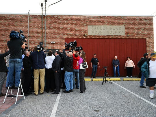 Tom Wolf is surrounded by members of the media after voting at the Eagle Fire Co. in Mount Wolf on Election Day 2014.
