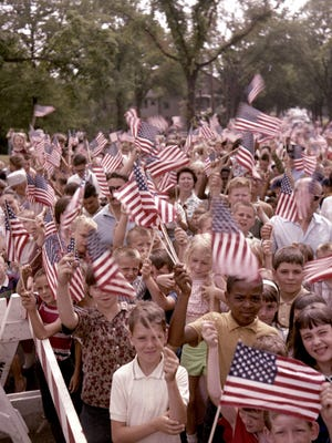 Children wave flags during an Independence Day celebration in Washington Park on July 4, 1966.