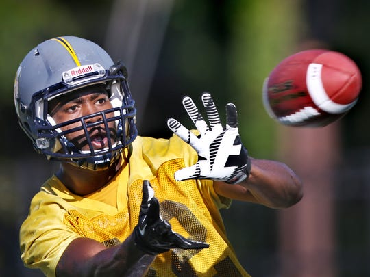 Marian University sophomore wide receiver Jimmie Walker Jr., who attended Southport High School in Indianapolis, is shown during practice on Sept. 25, 2014.