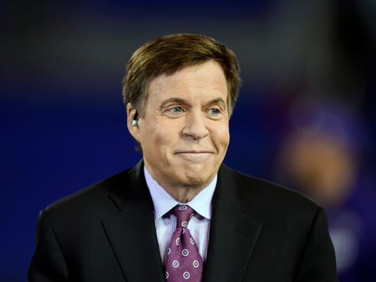 FILE - In this Nov. 10, 2016, file photo, sportscaster Bob Costas sits on a stage before an NFL football game between the Baltimore Ravens and the Cleveland Browns, in Baltimore. Costas has won the Ford C. Frick Award presented by the baseball Hall of Fame for broadcasting excellence. The honor was announced Wednesday, Dec. 13, 2017, at the winter meetings. (AP Photo/Gail Burton, File)