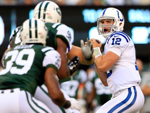 EAST RUTHERFORD, NJ - AUGUST 07: Quarterback Andrew Luck #12 of the Indianapolis Colts drops back to pass against the New York Jets during a preseason game at MetLife Stadium on August 7, 2014 in East Rutherford, New Jersey.  (Photo by Alex Trautwig/Getty Images)