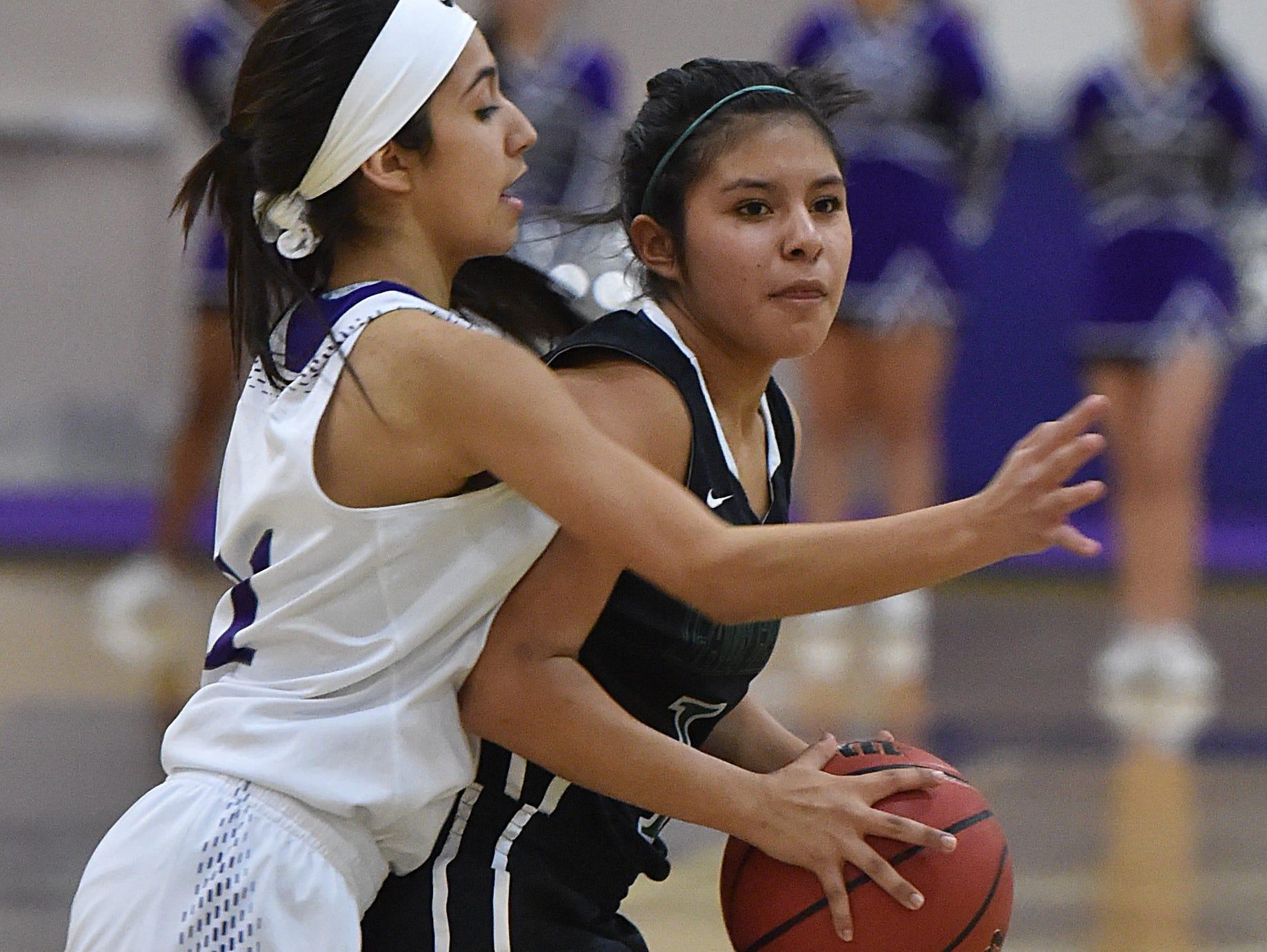 Spanish Springs' Naelia Pinedo pressures Hug's Jammie Moreno during Tuesday's game at Spanish Springs.