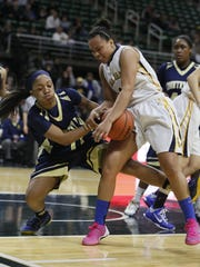 Goodrich's Alexis Sevillian, right, grabs a rebound during a Class B semifinal last season. She has developed into an excellent point guard and go-to player for the Martians.