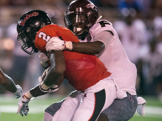Maryville's Isaiah Cobb is tackled by Fulton's DeShawn