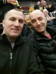 Shane and Shawn Green take in a Wichita State basketball game last season.