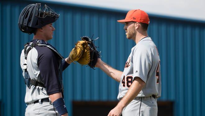 Tigers catcher James McCann, left, and pitcher Matt Boyd meet during a spring training workout Feb. 15, 2017 in Lakeland, Fla.
