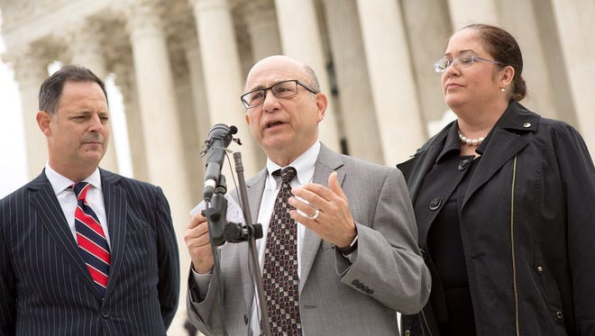 From left: State Rep. Rafael Anchia; Jose Garza, an attorney for the Mexican American Legislative Caucus; and Nina Perales, vice president of litigation for the Mexican American Legal Defense and Educational Fund, spoke on the steps of the U.S. Supreme Court on April 24, 2018. Their news conference came after arguments in Abbott v. Perez, a case over whether Texas' congressional and state House maps were drawn with the intent to discriminate against Hispanic and black voters.