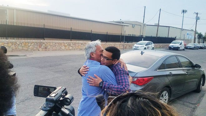 Emilio Gutierrez Soto and his son, Oscar, reunite after being released in July 2018.