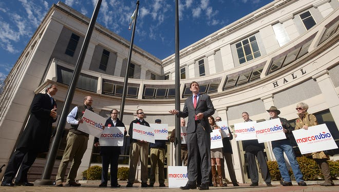 Backed by West Tennessee Supporters of Marco Rubio, State Sen. Brian Kelsey, R-Germantown, speaks during a rally outside of City Hall in Jackson on Thursday.