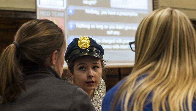 Isabel Spinti, a junior, consults with her teammates on how to answer a Juvenile Justice Jeopardy question at Great Falls High School on Tuesday afternoon. The game was purchased for Great Falls Public Schools by the Montana Board of Crime Control to help promote a better relationship between law enforcement and teens.