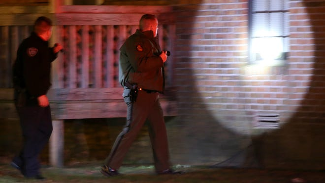Police investigate a shooting at an apartment building off of Garland Drive in Jackson on Thursday, Dec. 8, 2016.