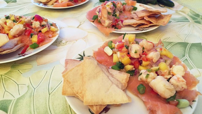 Smoked salmon and shrimp team up in this carpaccio/ceviche combination.