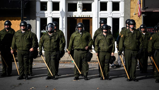 Tennessee state troopers line up near protesters during a White Lives Matter rally in Murfreesboro, Tenn., on Saturday, Oct. 28, 2017.
