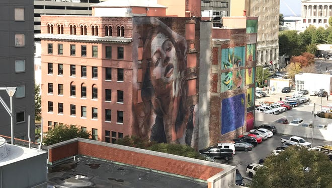 A lawsuitpitting a world-renowned muralist against a popular Christian singer-songwriter has left many wonderingjust what it means for tourists snapping photos of dozens in front of muralsacross the city.