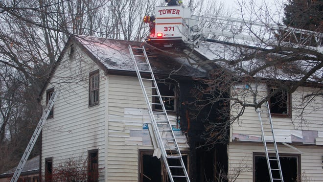A Penfield firefighter received minor injuries battling a fire at an unoccupied home under renovations at 49 Harwood Circle.