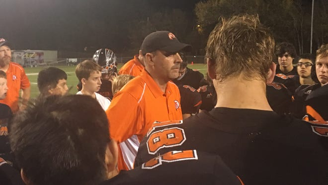 Nocona head coach Brad Keck talks to his team Friday after the Indians 40-35 loss to Leonard.