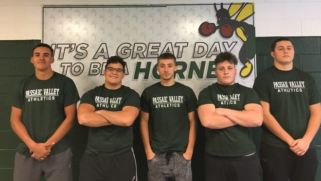 Passaic Valley football first-team all-conference players: (from left) Michael Bright, Tommy Marretta, Shawn Potenzone, Anthony Gennarelli and Matt Jaeger.