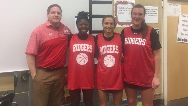 Glen Ridge girls basketball: (from left) coach Joe Mazzarella and team captains Lindsay Jaiyesimi, Jenny Lisovicz and Claire McMahon.