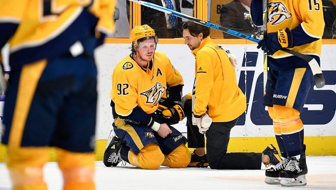 Predators center Ryan Johansen (92) is tended to after a hard hit during the second period Tuesday against the Golden Knights at Bridgestone Arena.