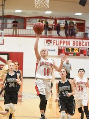 Norfork's Macy Dillard skies for a layup during the Lady Panthers' 64-55 win over Jasper in the championship game of the Arvest Bank Tournament on Saturday in Flippin.