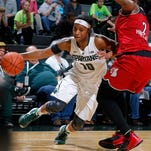 Michigan State's Branndais Agee, left, drives against Louisville's Myisha Hines-Allen Thursday, Dec. 3, 2015, in East Lansing, Mich. Michigan State fell 85-78.