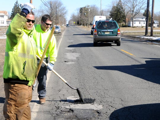 File: Vineland Public Works employees Albert Alvarado (left) and Kyle Suprun fill in potholes on Chestnut Avenue east of Lincoln Avenue in Vineland on Monday March 1, 2010.