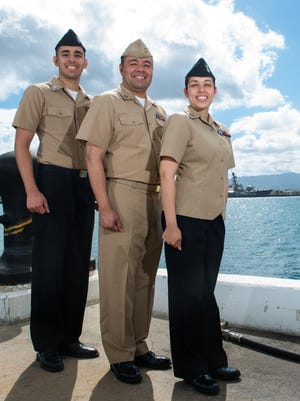 Navy Petty Officer 1st Class John Pacheco, left, Navy Lt. John Pacheco, center, and Navy Petty Officer 1st Class Christine Smith, all of the Somerset section of Franklin, pose for a photo at Joint Base Pearl Harbor-Hickam, Hawaii, July 29, 2016, while serving together for the Rim of the Pacific maritime exercise.