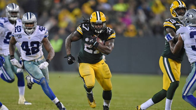 Green Bay Packers running back Eddie Lacy (27) runs through the defense on the fourth quarter against the Dallas Cowboys at Lambeau Field.