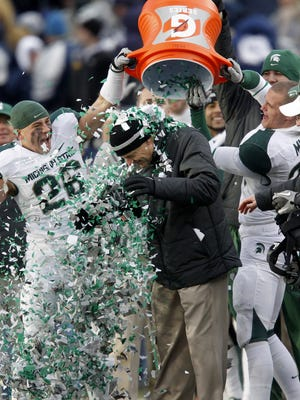 MSU players dump confetti over coach Mark Dantonio's head at the conclusion of the Spartans' win at Penn State on Nov. 27, 2010. MSU won 28-22 to earn a share of the Big Ten title.