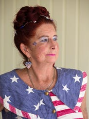 Mary Demere, 58, poses for a portrait in the flag dress
