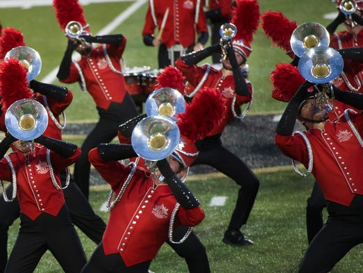 Music City Drum Corps performs at the annual competition for Drum Corps International, a competitive marching band organization, Friday, July 25, 2014 at Vanderbilt Stadium.