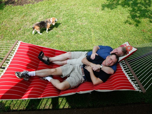 Mark Phariss and Vic Holmes relax on a hammock while they enjoy a Saturday at their lake house in Gun Barrel City, TX.  Phariss and Holmes are the plaintiffs in the main Texas lawsuit seeking same-sex marriage rights.