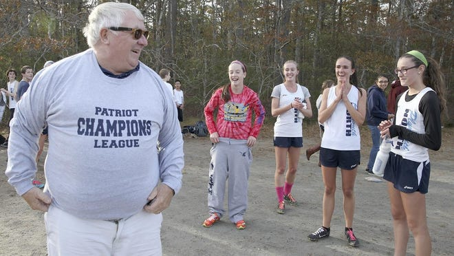 John Laverty led the Plymouth North boys and girls cross country teams to several Patriot League titles while coaching the Blue Eagles program.