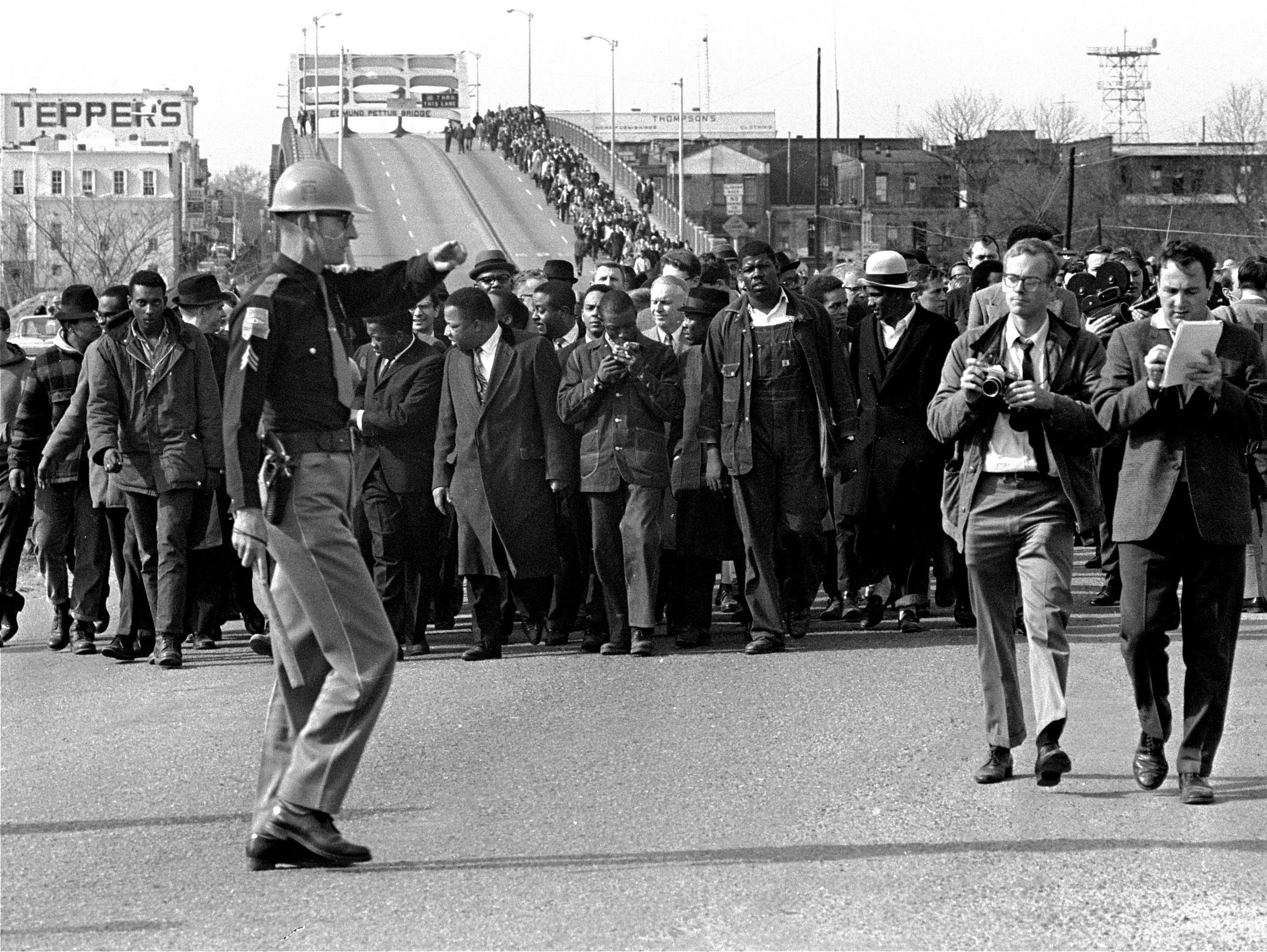 Demonstrators, including Dr. Martin Luther King Jr.,