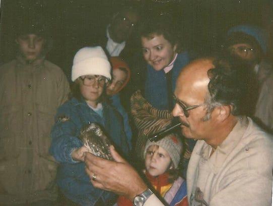 BernieBrouchoud demonstrating banding saw-whet owls