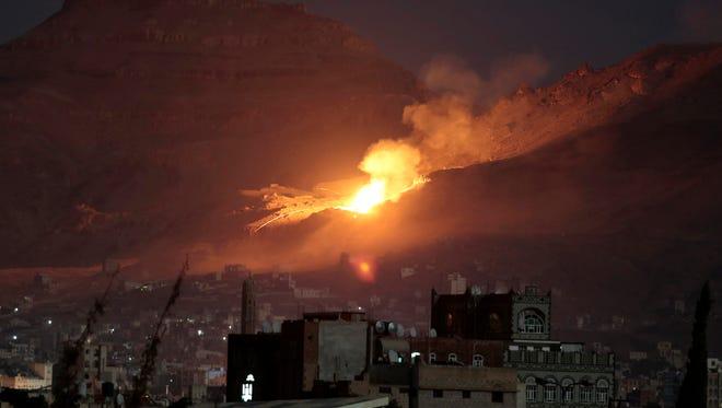 Fire and smoke rise after a Saudi-led airstrike  outside Yemen's capital, Sanaa, on Friday.