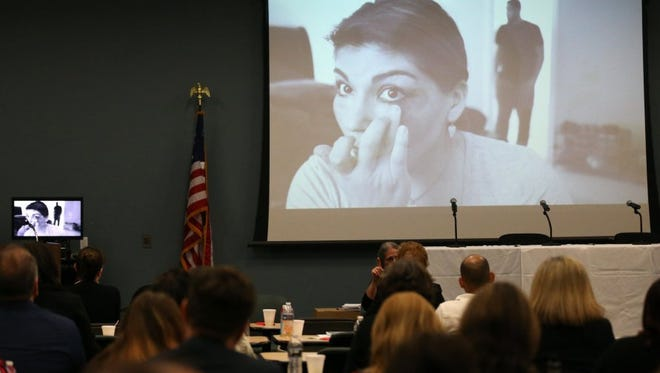 """A public service announcement created locally is shown during the """"Stop the Silence"""" Summit on Domestic Violence in December 2015 at the Del Mar College Center for Economic Development."""