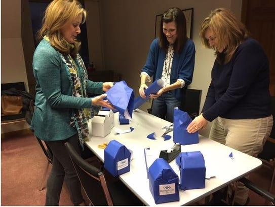 Denise Haring, Jessica Ney and Cheryl Meier, employees
